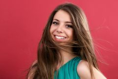 beautiful woman on red background Stock Images
