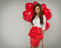 Beautiful woman with red balloon heart Stock Photos