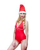 The beautiful woman in a red bathing suit and a red cap of Santa Claus Royalty Free Stock Photo