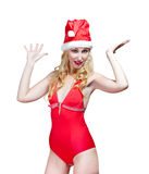 The beautiful woman in a red bathing suit and a red cap of Santa Claus Stock Photo