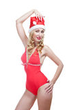 The beautiful woman in a red bathing suit and a red cap of Santa Claus. Portrait on a white background Stock Photo