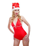 The beautiful woman in a red bathing suit and a red cap of Santa Claus.Portrait on a white background Royalty Free Stock Photos