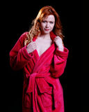 Beautiful woman in a red bathrobe Stock Photo