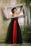 Beautiful woman in a red and black dress stock image