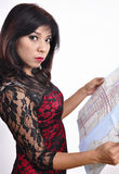 Beautiful woman red black dress reads travel map Royalty Free Stock Image