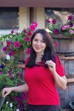 Beautiful woman in a red blouse in a flower bed stock photography