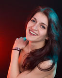 Beautiful woman in red and blue light royalty free stock photography
