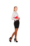 Beautiful woman with red book in hands standing Stock Photography