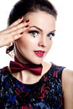 Beautiful woman with red bow-tie Royalty Free Stock Photography