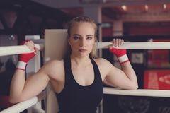Beautiful Woman with the Red Boxing Gloves. Attractive Female Boxer Training. royalty free stock image