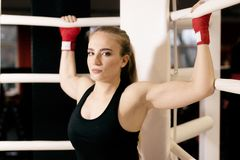 Beautiful Woman with the Red Boxing Gloves. Attractive Female Boxer Training. royalty free stock photo