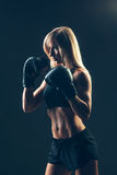 Beautiful woman with the red boxing gloves,black Royalty Free Stock Photography