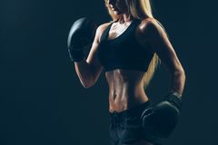 Beautiful woman with the red boxing gloves,black Royalty Free Stock Photos