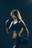 Beautiful woman with the red boxing gloves,black Stock Photography