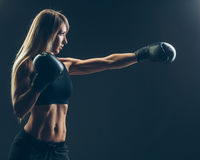 Beautiful woman with the red boxing gloves,black background Stock Image
