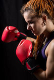 Beautiful woman with red boxing gloves, dreadlocks Royalty Free Stock Images