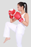 Beautiful woman with the red boxing gloves. Isolated on grey background Royalty Free Stock Photo