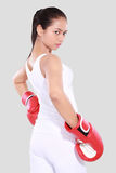 Beautiful woman with the red boxing gloves. Isolated on grey background Stock Images