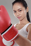 Beautiful woman with the red boxing gloves Royalty Free Stock Photography