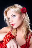 Beautiful woman with red bud of roses Stock Photos