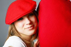 Beautiful woman in red cap Stock Image