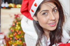 Beautiful woman with red christmas hat Stock Images