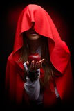 Beautiful woman with red cloak hoding apple Royalty Free Stock Image