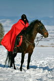 Beautiful woman with red cloak with horse riding Stock Photo