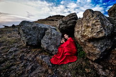 Beautiful woman with red cloak. Outdoor stock photos