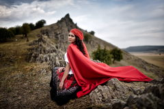 Beautiful woman with red cloak Stock Photos