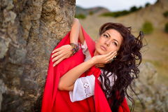 Beautiful woman with red cloak Stock Photo
