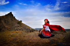 Beautiful woman with red cloak outdoor Stock Photos