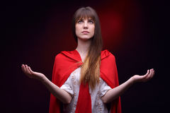 Beautiful woman with red cloak Stock Photography
