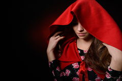 Beautiful woman with red cloak in studio Stock Photos