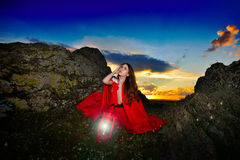 Beautiful woman with red cloak in the sunset light Royalty Free Stock Photos