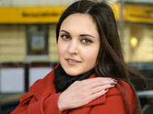 Beautiful woman in red coat on plein air Royalty Free Stock Image