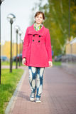 Beautiful woman in red coat walking autumn street Royalty Free Stock Images