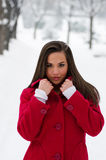 Beautiful woman in red coat in winter stock image