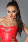 Beautiful woman in red corset Royalty Free Stock Images