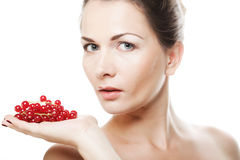 Beautiful woman with red currant Stock Photos