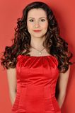 Beautiful woman in a red dress. Stock Photos