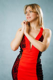 Beautiful woman in red dress. On blue background Royalty Free Stock Photography