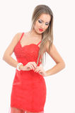 Beautiful woman in red dress arranges her hair Royalty Free Stock Photos