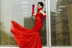 Beautiful woman in red dress Stock Image