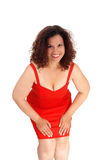Beautiful woman in red dress bending. Royalty Free Stock Photo