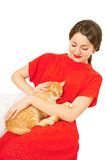 Beautiful woman in red dress with a cat Royalty Free Stock Photos