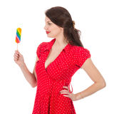 Beautiful woman in red dress with colorful lollipop stock image