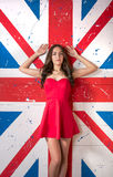 Beautiful woman in the red dress in front of the British flag Stock Photo