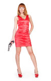 Beautiful woman in a red dress with a gun Royalty Free Stock Images