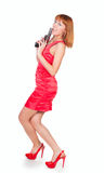 Beautiful woman in a red dress with a gun Stock Image